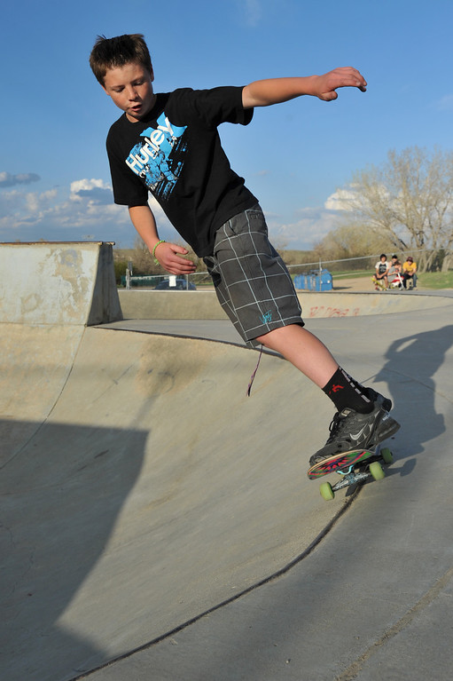 Riley Lewis, 13, does a 50-50 Grind on the bowl Thursday, May 9, 2013, at Sheridan Skate Board Park. (The Sheridan Press/Justin Sheely)