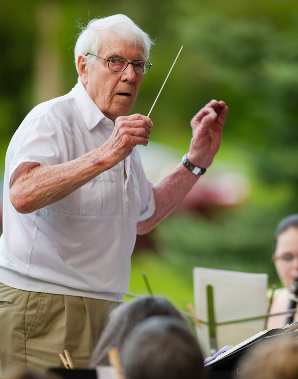 Bill Avery, 90, conducts the band during Concerts in the Park Tuesday evening at Kendrick Park. The performance was a tribute to the former Sheridan High School Band Director who taught band from 1950 – 1985. Band members included those who were former students of Avery. July 16, 2013. (The Sheridan Press/Justin Sheely)