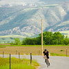 David Carter speeds down State Highway 335 in a time trial last Wednesday with the Bomber Mountain cycling club in Big Horn.