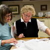 Letha Kegerreis, left, shows documents to Wyoming Room Director Judy Slack after the presentation of the Cemetery Tour at the Sheridan County Fulmer Library Wyoming Room Tuesday. Kegerreis was hoping to correct her great grandfather's death records, which incorrectly show that he died as a young child.