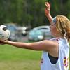 Ninth grader Neci Sundquist prepares a serve in a volleyball game during Dayton Days Saturday at Scott Bicentennial Park in Dayton.