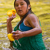 12-year-old Virginia Crooked Arm, from Wyola, Mont., tosses rubber ducks onto the bank of the Tongue River during the Dayton Days Duck Race Saturday at Scott Bicentennial Park in Dayton.