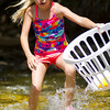 Aurora Switzer, 8, splashes through the Tongue River to catch a duck during the Dayton Days Duck Race Saturday at Scott Bicentennial Park in Dayton. The Switzer family are regular attenders to Dayton Days.