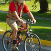 Chuck Vine rides on his bike during Dayton Days Saturday at Scott Bicentennial Park in Dayton. Vine says that biking is a much faster way to get around when there are a lot of people in town.