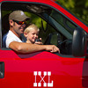 Nolan Bernard, 3, greets the audience through the loud speaker on the IXL Ranch Fire truck with his father Chris Bernard during the Dayton Parade Saturday in Dayton.