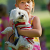 """Rivers Robins, 6, holds 1-year-old DC, a Maltese dog, for the Dayton Days Pet Parade Friday at the Scott Bicentennial Park in Dayton. """"The Pet Parade is not a competition,"""" says organizer Patty Kemper, """"It is just for fun, everyone gets a ribbon and no one goes home crying."""""""