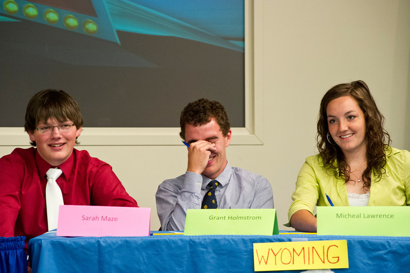Team Wyoming high school students laugh after team Montana correctly answered a Wyoming question that they had missed during the Montana-Wyoming Academic Challenge Thursday at Sheridan College. From left, Michael Lawrence, of Riverside, Grant Holmstom, from Laramie, and Sarah Maze, Tongue River High School. The competition had 300 questions over a total of 5 rounds, 60 questions for each round. Wyoming won the challenge with 133 questions against Montana's 93. Each member of the winning team will be awarded one year of tuition-free scholarships at Sheridan College.