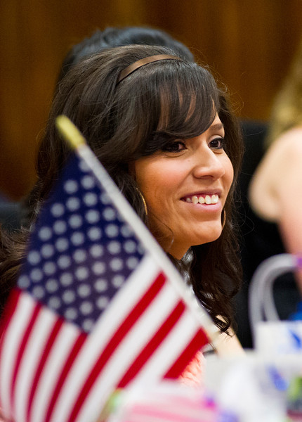 Brenda Soto, from Mexico, smiles after being recognized as a naturalized American Citizen during the Naturalization Ceremony at the Sheridan County District Court.