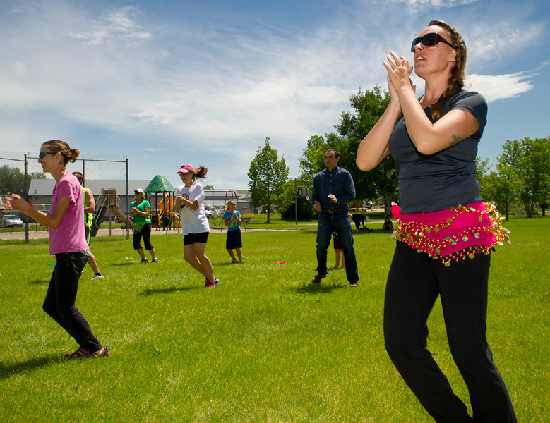 """Sonja Luckow, right, claps her hands as she follows the Zumba instructor's lead during Parkfit Wednesday at Washington Park. Parkfit offers free community workouts on Wednesdays and Fridays in the parks of Sheridan. The Parkfit schedule can be found at the Wellness Council of Sheridan County:  <a href=""""http://www.wellnesscouncilsc.org"""">http://www.wellnesscouncilsc.org</a>"""