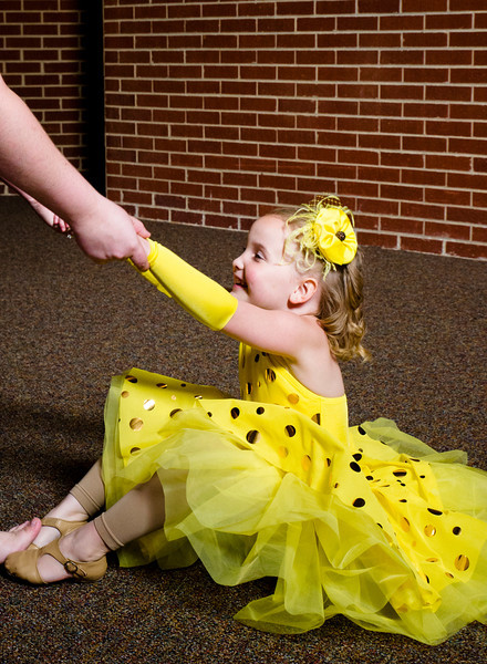 MaKaylee Robles, 5, is helped up by her chaperone after taking a tumble while practicing a dance during the Little Miss Wyoming Pageant Saturday at the Sheridan Junior High School Early Auditorium. Robles, from Green River, Wyo., was awarded as Tot Miss Wyoming 2013.