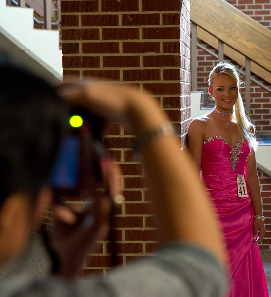 Samantha Taylor, of Gillette, Wyo., poses while her makeup artist takes a photograph Saturday in the Early Auditorium at the Sheridan Junior High School. Talyor was crowned as the 2013 Teen Miss Wyoming during the pageant last weekend.