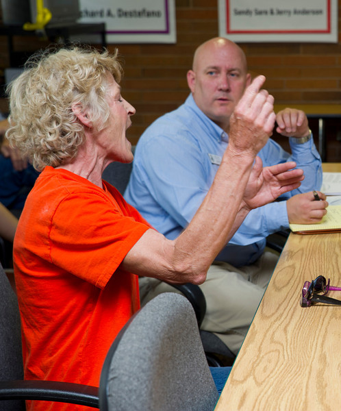 """Margaret Halliburton waves her hands as she expresses her concerns to Field Representative Matt Jones, of House Rep. Lummis, and others during """"Office Hours"""" Friday morning in the Whitney room at the YMCA. Field Representatives from the offices of Sen. Barrasso and Sen. Enzi were also present to listen to Sheridan residents."""