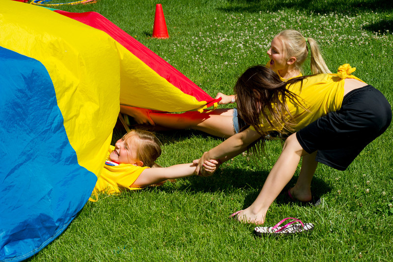 Taylinn Swope, right, pulls Hailey Foote free from the shark in a game of lifeguards and sharks during Vacation Bible School Wednesday at the YMCA.