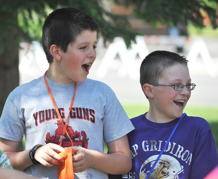 Gaige Vielhauer, left, and Tristian Thompson, 10, laugh during a game of monkey in the middle during Community Vacation Bible School at Saint Peter's Episcopal Church. The Community VBS this week is a joint by several Churches in Sheridan who's volunteers engage kids in activities, science projects, and religious studies.