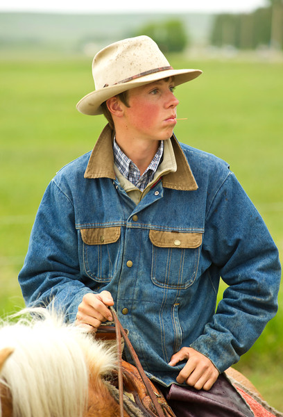 Evan Henderson, 15, waits on his horse at the starting line in Dayton for the first annual Horse Race and Poker Run to Parkman on Saturday.