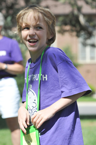 Jude Mairoca, 9, turns around as he tries to catch the sack in a game of monkey in the middle during Community Vacation Bible School at Saint Peter's Episcopal Church.