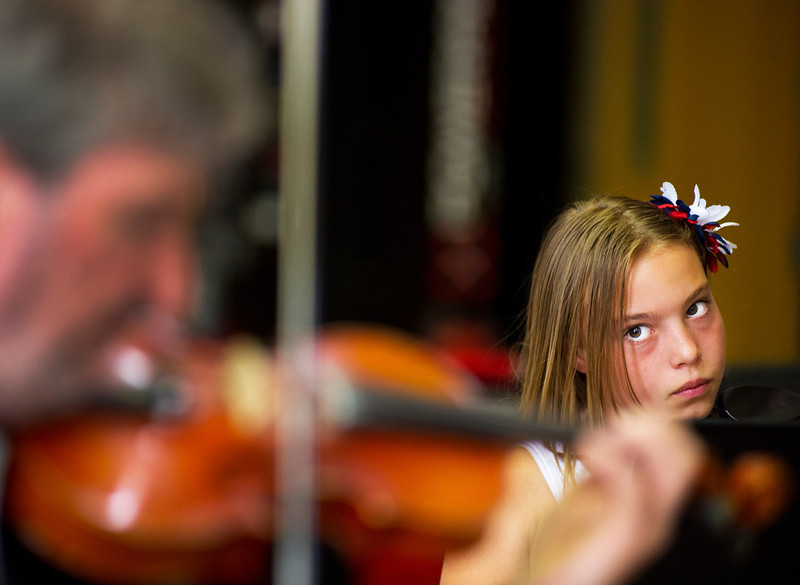 Katie Dahl, 9, watches instructor Razmick Sarkissian play the Violin during Wednesday's practice at Sheridan High School. The Summer Strings Program will feature performances by Sheridan County School District 2 students in the Elementary, intermediate and Advanced Orchestra. The Concert will be held at the Sheridan High School Commons this Friday, June 14, at 12:15 p.m. and is free to the public.