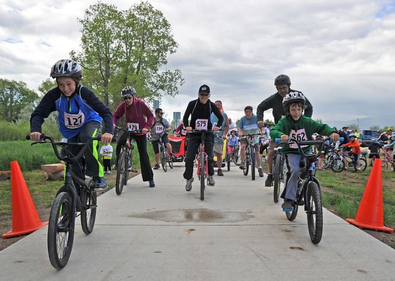 Bikers take off from the starting line in Saturday's Park2Park run, bike, or stroll event at South Park. From left, Oliver Bartel, 127, Sara Bartel, 179, Emily Nelsen, and Hendrik Bartel, 562. The bikers followed the 10-mile route from South Park to North Park on Sheridan's Pathways.