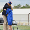 Doug Raney hugs Brianna Lindberg Sunday afternoon at SHS graduation.