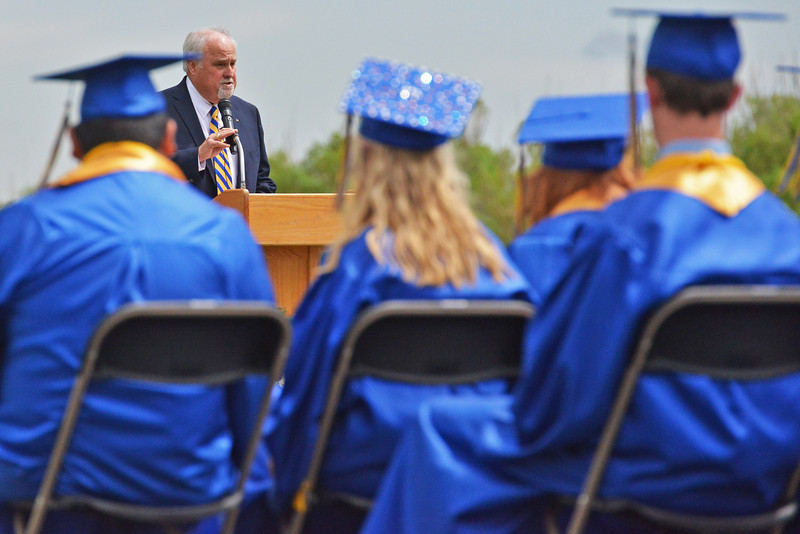 Speaker Doug Raney addresses the SHS class of 2013 Sunday afternoon. The longtime social studies teacher Raney is retiring this year.