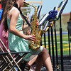 Catherine Winnop plays along with the SHS band while graduates process to their seats Sunday afternoon on Scott Field.