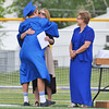 Hadyn Richins hugs his mom Heidi Richins next to SHS principal Dirlene Wheeler after receiving his diploma Sunday afternoon.