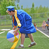 Colton Bates collects a loose beach ball for his fellow classmates as his name is called for his diploma presentation Sunday aftertnoon at SHS graduation.