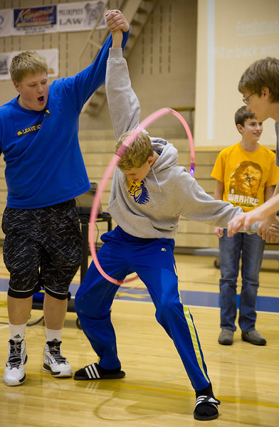 Students race the hula-hoop up the human chain.