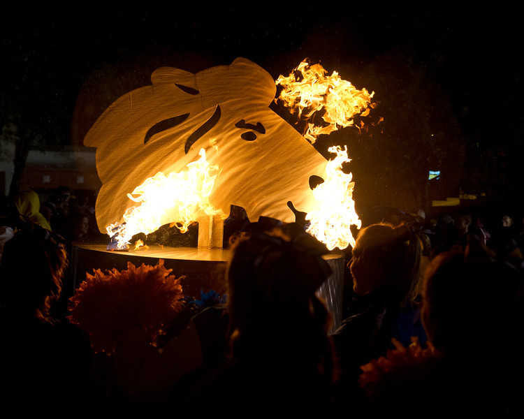 Flames ignite around the Sheridan Broncs' metal sculpture head during the Homecoming celebration on Grinnell Plaza Thursday night.