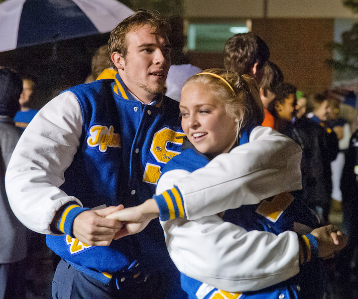 Homecoming King and Queen Tyler Julian and Molly Ligocki dance during the Homecoming celebration downtown Sheridan on Thursday.