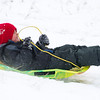 Kyler Mines, 5, slides down Lindon Hill Tuesday afternoon after a spring snow storm.