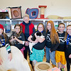 Cel Hope, in back, stands with the Teeny Tinies group at the Dog and Cat Shelter on Friday, April 12, 2013. The Teeny Tinies from left, Kate Alsup, Aleyah Eisele, Ahlexa Bradshaw, Sheridan Blackburn, Mary Nicholson, and Mallory Arneson.