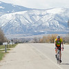Dave Olson rides his bike near the intersection of Route 335 and U.S. Highway 87 on Wednesday. Olson is training for the RATPOD bike race, a fundraiser in Dillion, Mont., this June.