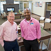 Dr. Greg Marino, left, and Pharmacist Lekan Ajay stand inside the lobby area of the Welch Cancer Center on Wednesday.