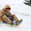 Dusten Morris, left, takes his 16-month-old son Creedyn for a ride down Lindon Hill on Tuesday.