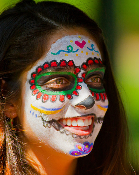 Laura Nunez of Mexico displays her Day of the Dead face painting during the Up with People Culture Fair Thursday at Kendrick Park. The Day of the Dead is a Mexican Holiday celebrated November 2.
