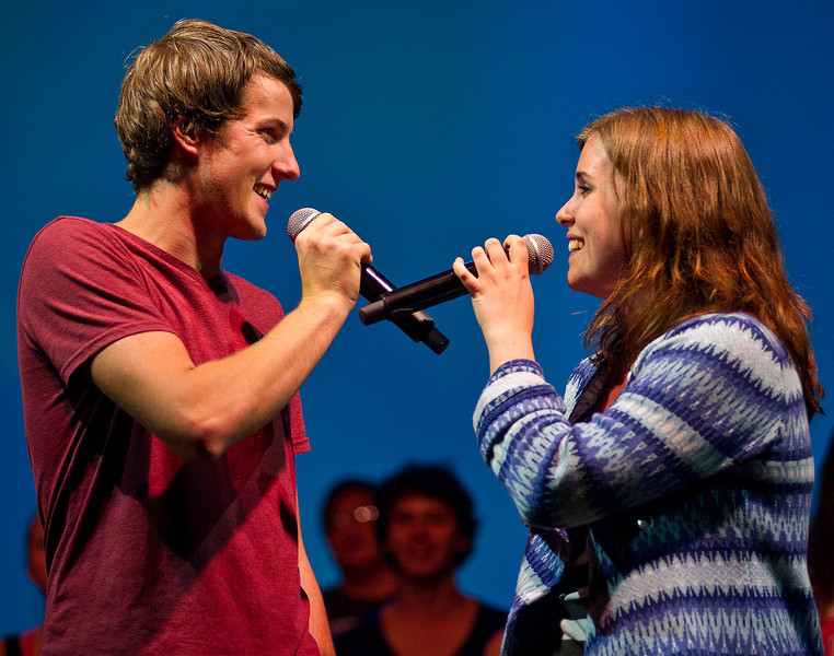 "Cast members Caleb Reed, left, of Tuscan, Ariz., sings with Ylva Sefastsson, from Sweden during the rehearsal for the Up with People ""Voices"" show Friday in the Early Auditorium at the Sheridan Junior High School."