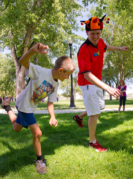 Nathan Ulery, 10, follows Bert Walbers lead in a Belgium 'Jump Style' dance during the Up with People Culture Fair Thursday at Kendrick Park. Walbers is a cast member from Genk, Belgium.