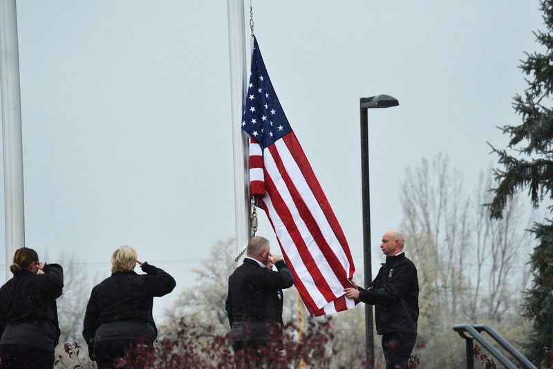 The Sheridan College Veterans Club presents the colors, rasing the American flag during the SC Veterans Day Ceremony Monday morning. (The Sheridan Press/Brad Estes)
