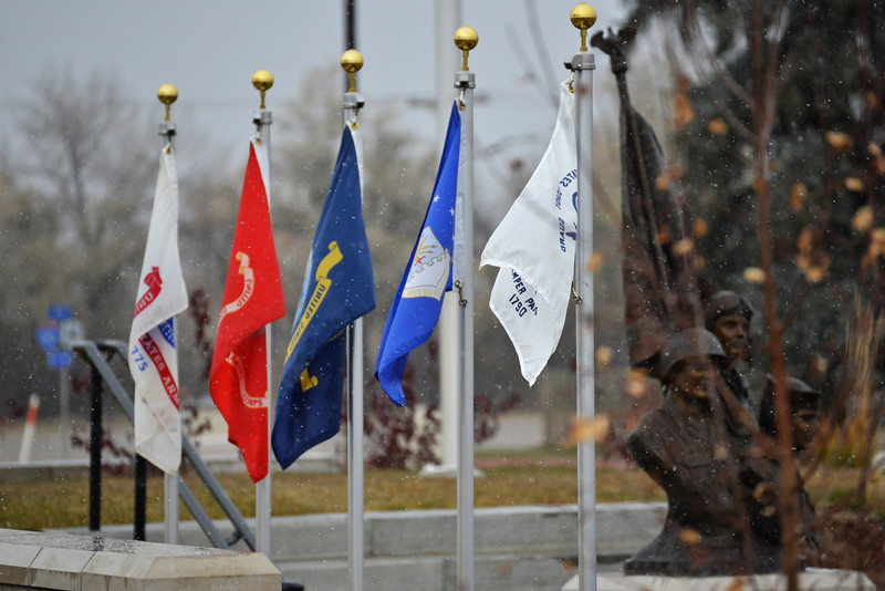 Flags for the different branches of military sit on the veterans plaza at Sheridan College during the SC Veterans Day Ceremony Monday morning. (The Sheridan Press/Brad Estes)