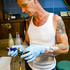 Free Hand Rob assembles the tattoo machine with a disposable tube and needle Friday at Your Moms Favorite Tattoo Parlor on North Main Street.