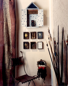 One of many arrangements in the artmosphere showroom set up by Julian Maison and Marcel Maison. this features Amazonian spaears, african headdress, Oratory and artwork made using peices from afro-brasilian religious offerings or macumba. on the right an african Kuba cloths hangs.