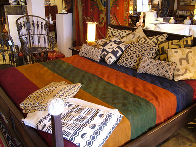 One of many arrangements in the artmosphere showroom set up by Julian Maison and Marcel Maison. The bed we deisgned with sotne finials, cushions were custom made from african mud cloths and kuba cloths.
