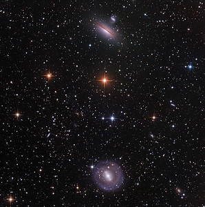 """NGC 5101 and 5078 in southern Hydra, and literally hundreds of distant friends. There is a nice cluster of distant orange galaxies about 20% of the way toward 8 o'clock from centre. 5101 is a delicate face-on spiral. 5078 is an edge-on spiral with branching dust lanes across the more orange centre, and interacting with a companion.   Lum 7 hrs in 1hr subs. RGB 2.5hrs each in 30 min subs. Aspen CG16M on 20"""" PlaneWave. As always, all processing using our own in-house software, GoodLook 64."""