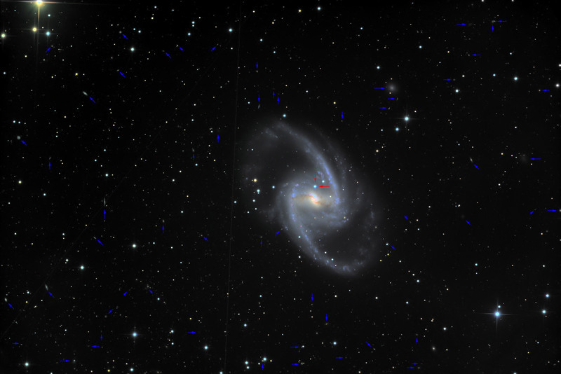 "NGC 1365 with the 2012 supernova labelled in red, and some 58 background galaxies in blue. For the original image, see <a href=""http://mikeberthonjonesastro.smugmug.com/Category/Astrophotography-at-Placidus/25651846_F8c7kG#!i=2238910766&k=f8T6rtc&lb=1&s=A"">here"
