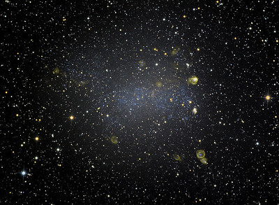 """Barnard's Galaxy. The """"3rd Magellanic Cloud"""" - a satellite of the Milky Way about 1.6 MLyr distant. 3nM H-alpha mapped to yellow. Ha 13h L 13h RGB 90m. This photo shows deeper-than-usual faint features in H-alpha.  STL11000M on 20"""" PlaneWave CDK on modified MI-750 fork. All software, firmware, and electronics is my own design and build."""