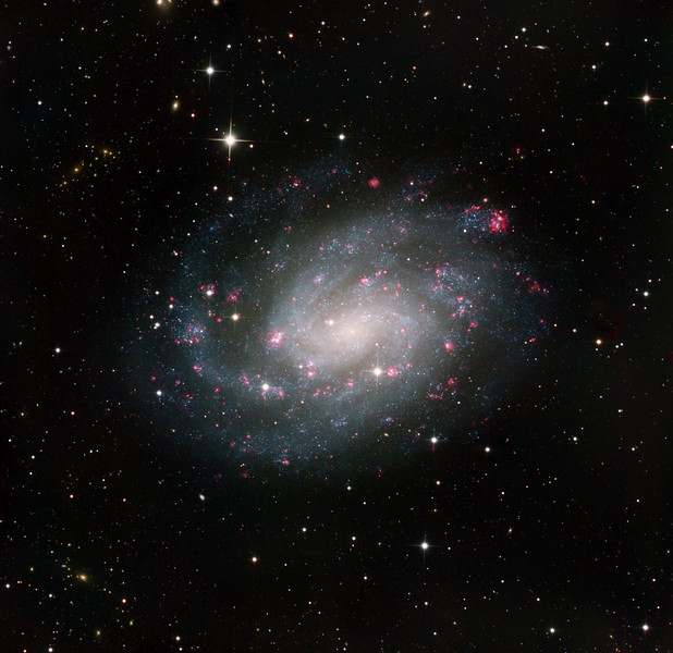 "NGC 300 in RGB, with an additional 13hrs of hydrogen alpha mapped to red.<br /> <br /> The H-alpha shows a zoo of star-forming regions, mostly as smoke-ring structures, splattered along the spiral arms.<br /> <br /> L 10hrs 1x1, RGB 4hrs each 2x2, H-alpha 13 hrx 2x2, all in 1hr subs. Aspen CG16M on 20"" PlaneWave CDK."