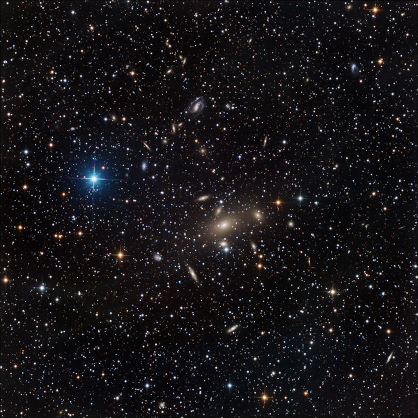 Galaxy cluster Abell South 605 in Pavo. A huge big fat wombat-sized elliptical dominates the centre. Towards 11 o'clock is the beautiful S-shaped spiral IC 4769. There are approximately 140 other galaxies visible in the image.<br /> <br /> Aspen CG16M on 20 inch PlaneWave. Lum 9.5 hrs; RGB 3 hrs each channel, all in 30 min subs.<br /> <br /> Field approx 36 min arc, 0.55 sec arc/pixel, North up.