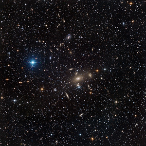 Galaxy cluster Abell South 605 in Pavo. A huge big fat wombat-sized elliptical dominates the centre. Towards 11 o'clock is the beautiful S-shaped spiral IC 4769. There are approximately 140 other galaxies visible in the image.  Aspen CG16M on 20 inch PlaneWave. Lum 9.5 hrs; RGB 3 hrs each channel, all in 30 min subs.  Field approx 36 min arc, 0.55 sec arc/pixel, North up.