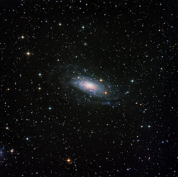 NGC 3621 in Hydra. The spiral arms are very faint, and take much exposure to show them. Luminance 9.5 hrs; RGB 90 min each. Aspen CG16M on 20 inch PlaneWave.